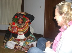 Masked dancer interacting with participant